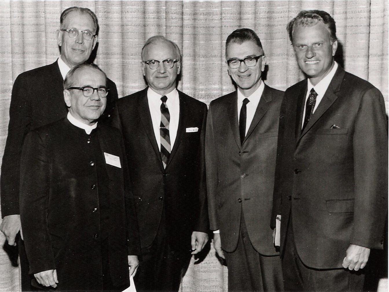 Five white men pose for a photograph